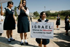 Armenian school girls hold signs as they demonstrate in front of the Israeli Foreign Ministry in Jerusalem in October, 2007.